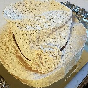 Cream crocheted hat with flower and brown band